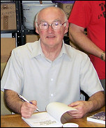 Peter Taaffe, Socialist Party geneal secretary, signs copies of his book