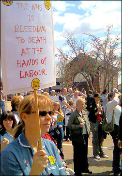 The NHS is bleeding to death  - placard on Stoke NHS demo