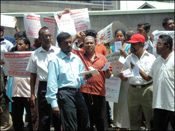 Strikers rally outside the Ministry of Health in Colombo, photo by CWI