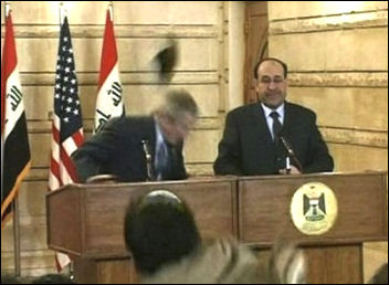 US President George W Bush humiliated by shoe attack
