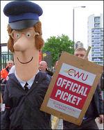 Postman Pat joins the CWU picket line in East London , photo N Byron