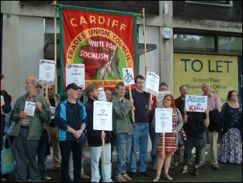 Disabled people, family members and anti-cuts campaigners took a protest to the Atos assessment centre in Swansea, photo Swansea Socialist Party