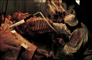 Meat being prepared at Smithfield market, photo Paul Mattsson