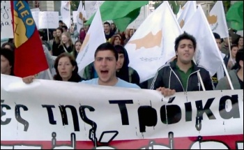 Cyprus workers protest against the Cypriot government's deal with the Troika - the IMF, Central bank and the EU, photo AFPTV J. Massad