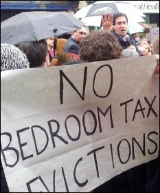 Ed Miliband avoids protesters against the Bedroom tax in Stroud, photo Chris Moore