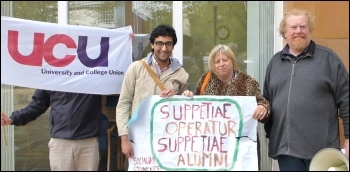 Socialist Students member Farid Norat with a Latin banner ('support the workers, support the students' ), next to the Unison secretary and a UCU committee member