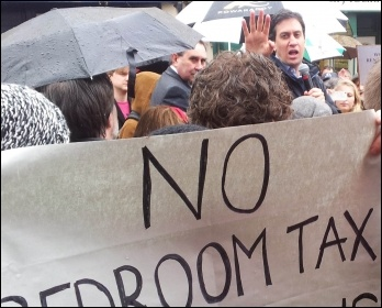 Ed Miliband confronted by anti-bedroom tax protestors demanding that Labour councils refuse to collect the tax, photo by Chris Moore