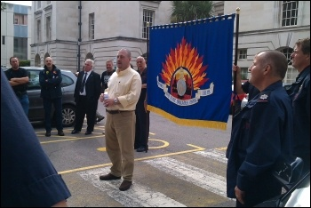 Paul Couchman speaks to the rally, photo Ginny Eaton