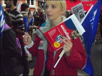 Striking teacher holding a Socialism2013 leaflet; London, 17.10.13 , photo by A. Hill