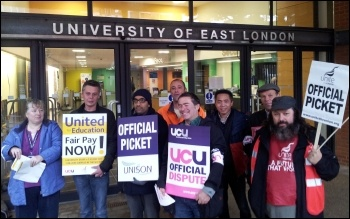 Joint strike action by university staff in the Unite, Unison and UCU unions was well supported at the University of East London 31 October 2013, photo P Mason