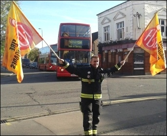 A picketer at Leyton fire station, London, photo by Sarah Wrack