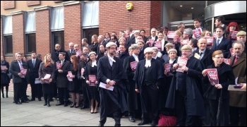 50 lawyers and barristers outside Leeds combined courts on Monday 6th January , photo by Tanis Belsham-Wray