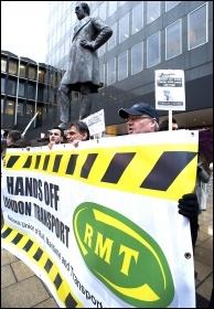 RMT members protesting outside London's Euston station, photo Paul Mattsson