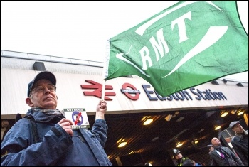 An RMT member takes part in the Euston Station protest, photo Paul Mattsson