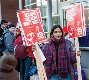 Socialist Seattle councillor Kshama Sawant hands out '$15 now' placards, photo by Socialist Alternative