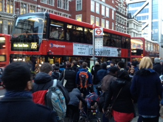 Queuing to get on a  packed 205 bus outside Liverpool Street station, 5.2.14 tube strike, photo by Judy Beishon