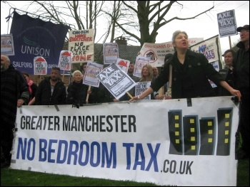Bedroom tax anti-eviction protest, Salford, 10.4.14, photo by Hugh Caffrey