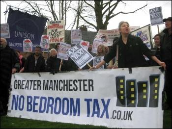 Bedroom tax anti-eviction protest, Salford, 10.4.14, photo Hugh Caffrey