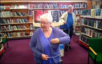 Chaining to the bookshelves, Rhydyfelin library, 31.5.14, photo by D Reid