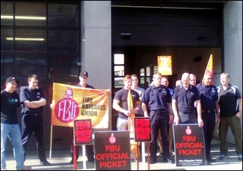 Nottingham firefighters on strike, 12.6.14. Nottinghamshire Fire Authority is planning £2.4 million worth of cuts. photo by Becci Heagney