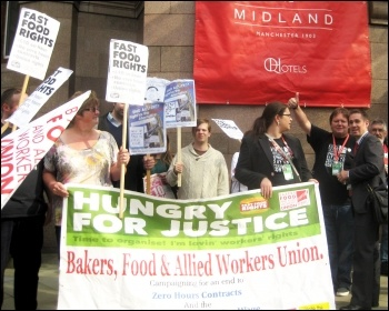 Fast Food Rights supporters, spearheaded by BFAWU bakers' union, demonstrate outside Labour's national conference in Manchester demanding and end to zero-hour contracts and a universal £10 minimum wage, 15 September 2014 , photo Hugh Caffrey