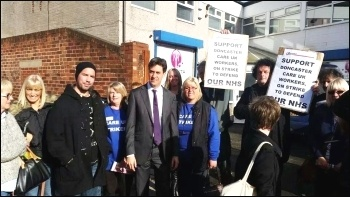 Care UK strikers 'photo-bomb' Miliband , photo A Tice