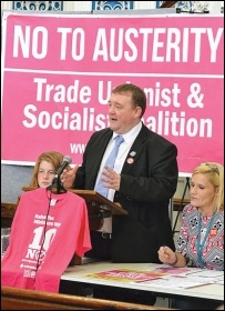 Anti-cuts councillor Wayne Naylor speaking at the Leicester People's Budget conference, October 2014, with fellow councillor Barbara Potter (right), photo by Ambrose Musiyiwa