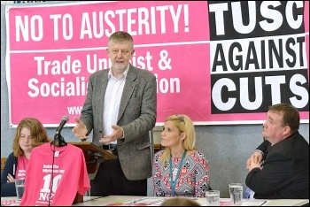 Dave Nellist speaking at the Leicester People's Budget conference, alongside Tessa Warrington (left), cllr Barbara Potter (centre) and cllr Wayne Naylor (right), photo Ambrose Musiyiwa