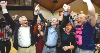 Joe Higgins (left) and Paul Murphy (centre) celebrate the October 2014 byelection victory
