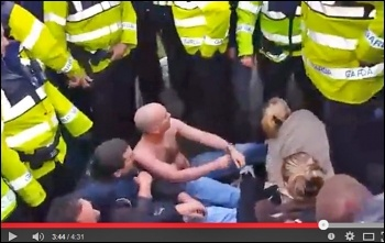 Socialist Party TD Paul Murphy being attacked by police on a water charges protest