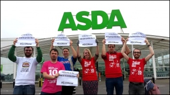 Protesting outside Asda in Britain in solidarity with Walmart workers in the US