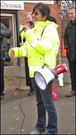 One of the Barbour marchers speaking to fellow strikers outside the company's HQ, photo by Elaine Brunskill