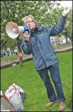 A TUSC campigner in Hackney calling for rent caps not benefit caps, photo Paul Mattsson