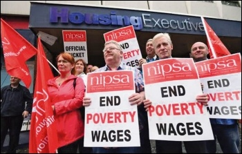 Trade unionists striking against poverty pay and against austerity