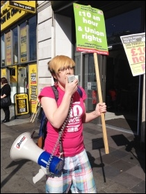 Helen Pattison, Youth Fight for Jobs, addressing protesters outside McDonalds, Marble Arch, London, 15.4.15, photo Judy Beishon