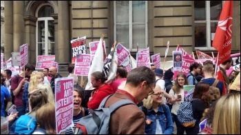 TUSC placards being distributed as the People's Assembly anti-austerity demonstration gathers in the City of London on 20th June., photo Sabah