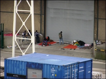 Migrants at Calais in previous years, photo by Tom Jervis (Creative Commons)