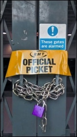RMT official picket armband on locked tube station gate, photo Naomi Byron