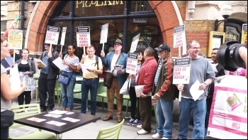 Protesters outside Pizza Express demanding an  end to the 8% admin fee the chain takes from staff tips paid by card. Coptic Street, London, Monday 10 August. Photo Rob Williams