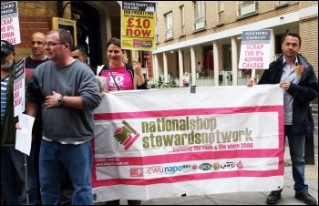 NSSN banner at a protest outside Pizza Express (NSSN chair Rob Williams on the right). September 2015