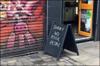'Sorry no poor people' sign outside Brick Lane Coffee, photo Facebook