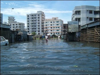 Flooding in Bangladesh, photo by dougsyme (Creative Commons)
