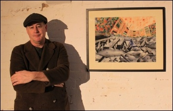 Bradford artist and Socialist Party member Peter Robson with some of his work, photo by Bradford Socialist Party