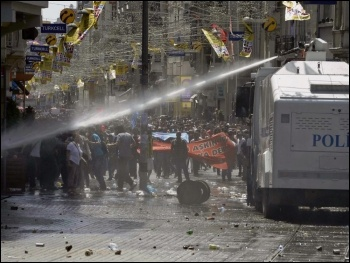 Police attack a protest in Turkey, photo by Lindsay T (Creative Commons)