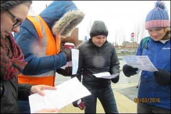 Gateshead, 9.3.16, reading the Socialist Party leaflet, photo by E Brunskill