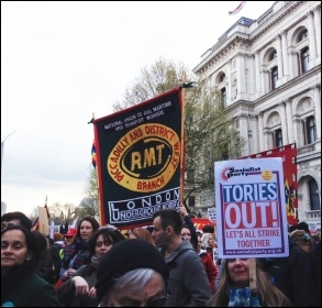 Piccadilly & District West RMT banner on the BMA-NUT led march, London, 26.4.16, photo by Judy Beishon
