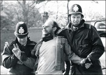 Police manhandling a striking miner