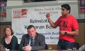 Victimised BFAWU rep Kumaran Bose (standing), photo Steve Score
