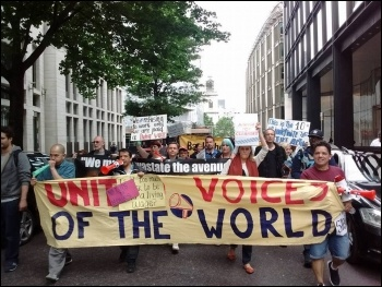 Striking cleaners demonstrate photo United Voices of the World