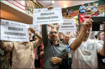 Delegates and observers at the 10th annual NSSN conference show solidarity with sacked bakers' union rep Kumaran Bose, photo by Paul Mattsson